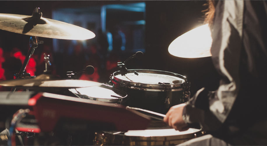 Close up photo on a musician playing the drums at a gig